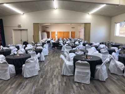 rev dr sharon stanley-rea room set up for a wedding with tables and chairs